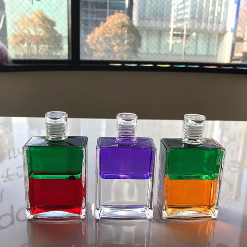 Aura-soma Color Therapy Counseling Glass - Material Container Indoors  No People Window Side By Side Bottle Table Transparent Close-up Choice Multi Colored Focus On Foreground Still Life Window Sill Purple