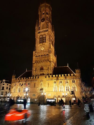 Belfort Townhall Bolid Red Bolid Christmas Bruges Night Illuminated Architecture Travel Destinations Christmas Decoration People Outdoors Politics And Government