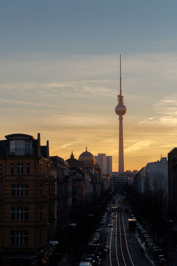 berlin sunrise Berlin TV Tower Architecture Building Exterior Built Structure City Cityscape Communication Day No People Outdoors Road Sky Spire  Sunrise Sunset Tall - High Television Tower The Way Forward Tourism Tower Transportation Travel Travel Destinations