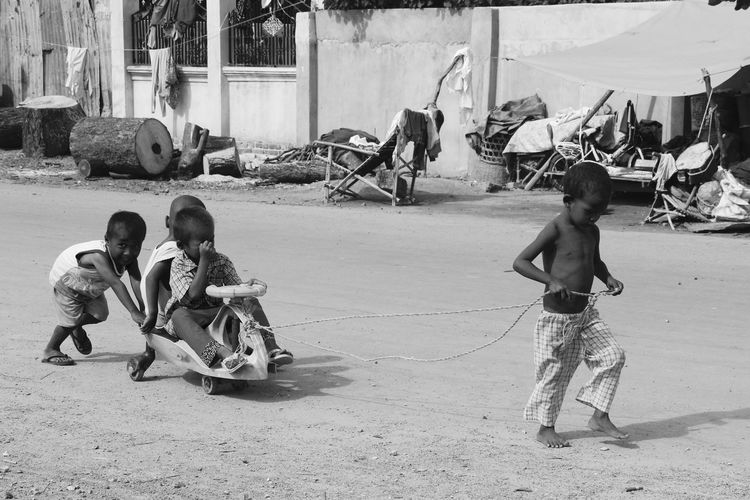 Kids playing on the streets of Mandalay Barefoot Beutiful Faces Childhood Fun Horse Carriage Kids Mandalay Myanmar New Game Playing Smiles Street Life Sunny Day