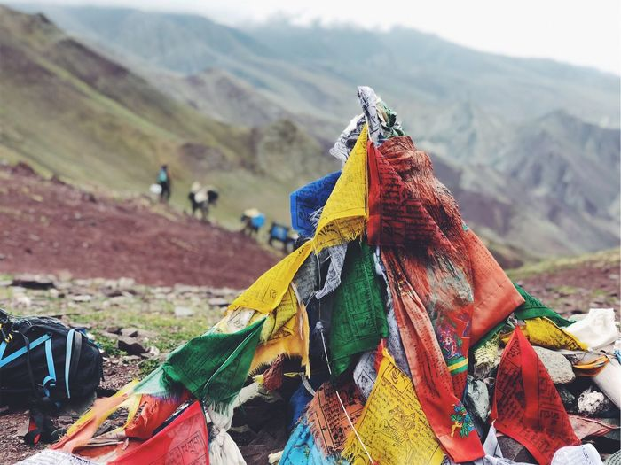 Multi colored prayer flags on mountain