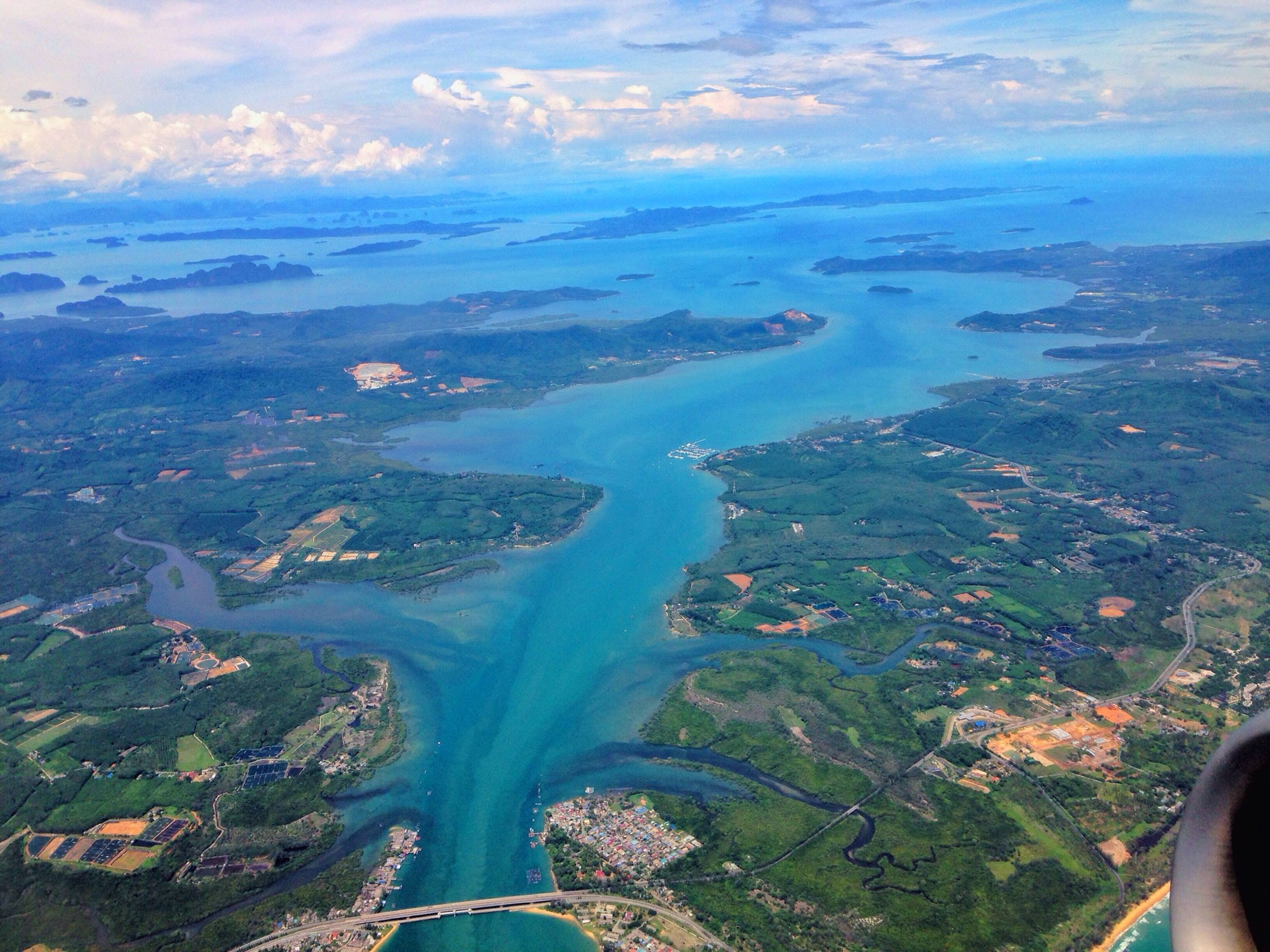aerial view, sky, scenics, transportation, landscape, beauty in nature, sea, nature, high angle view, airplane, tranquil scene, mode of transport, part of, water, mountain, cloud - sky, travel, vehicle interior, tranquility, cropped