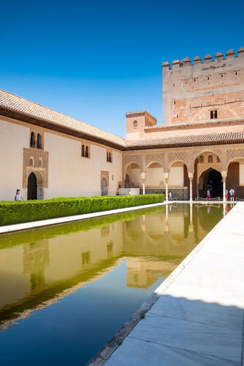 Alhambra (Granada) Alhambra De Granada  Granada, Spain The Week on EyeEm Alhambra Architecture Blue Building Building Exterior Built Structure Clear Sky Courtyard  Day History Incidental People Lake Nature Outdoors Plant Reflection Sky Sunlight The Past Travel Destinations Water