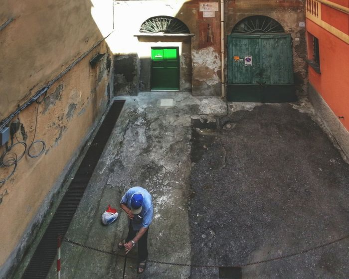 Sweeping. Broom And Blade High Angle View Built Structure Building Exterior Little Square Architecture One Person Adult Outdoors City Day Real People Adults Only People Camera Zoom FX Bracketing HDR Smartphone Photography Android Photography Street Note 2 Genova Alleyways Doors