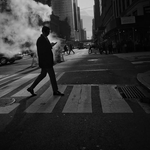 Street Building Exterior City Built Structure One Person Real People Architecture Outdoors Road TheMinimals (less Edit Juxt Photography) Blackandwhite City Life City Street