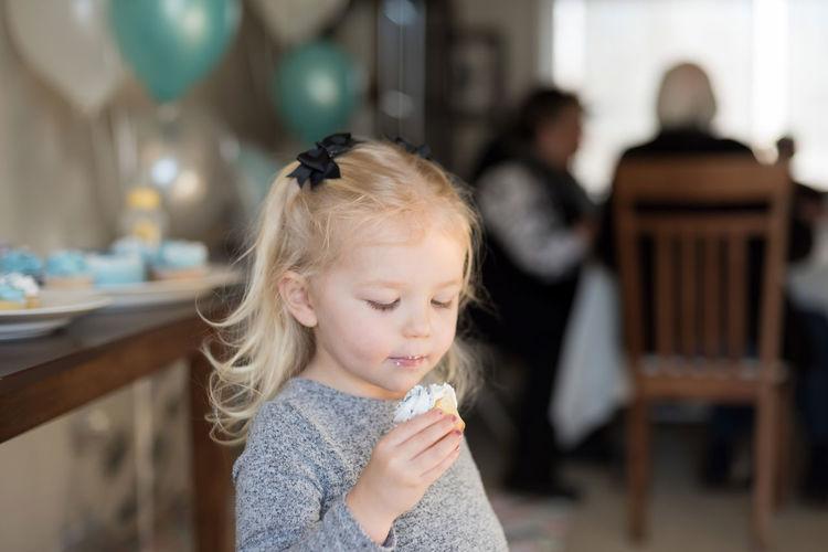 Close-up of cute girl eating food
