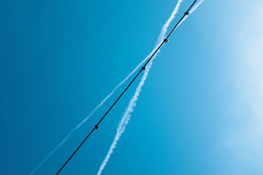 CROSSING Blue Sky Low Angle View Cloud - Sky Airplane Nature Day Vapor Trail Air Vehicle No People Transportation Copy Space Mode Of Transportation on the move Speed Motion Smoke - Physical Structure Airshow Outdoors Plane The Week On EyeEm Editor's Picks