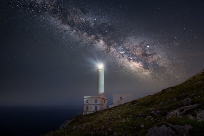 Lighthouse of punta palascia under the beautiful milky way. beautiful night. salento lecce otranto