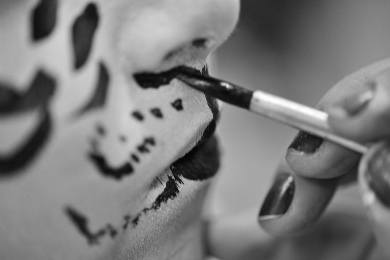 Cropped Image Of Woman Painting Face