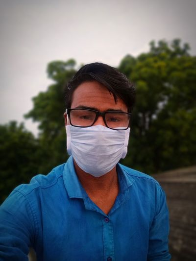 A man with surgical face mask