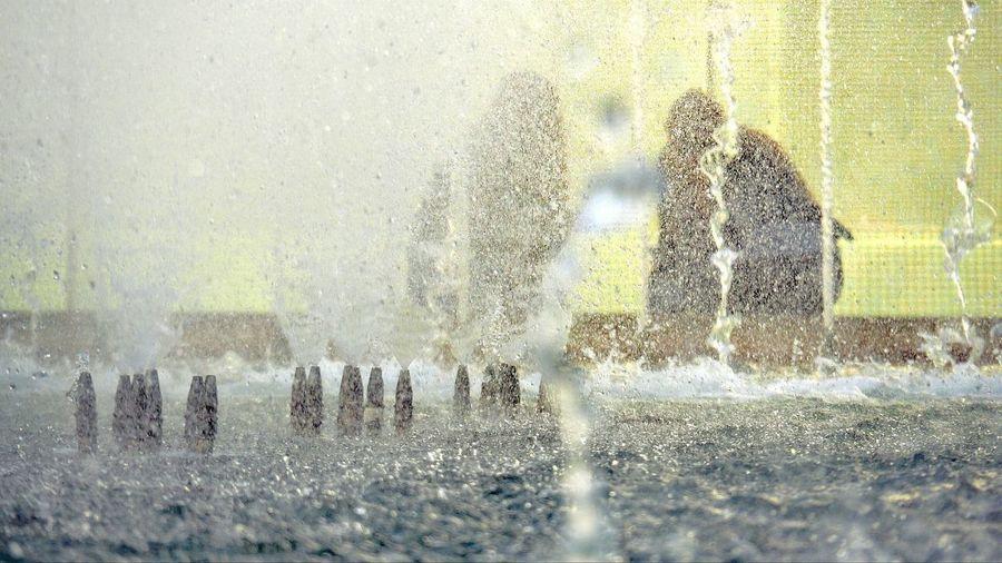 Water splashing against blurred background