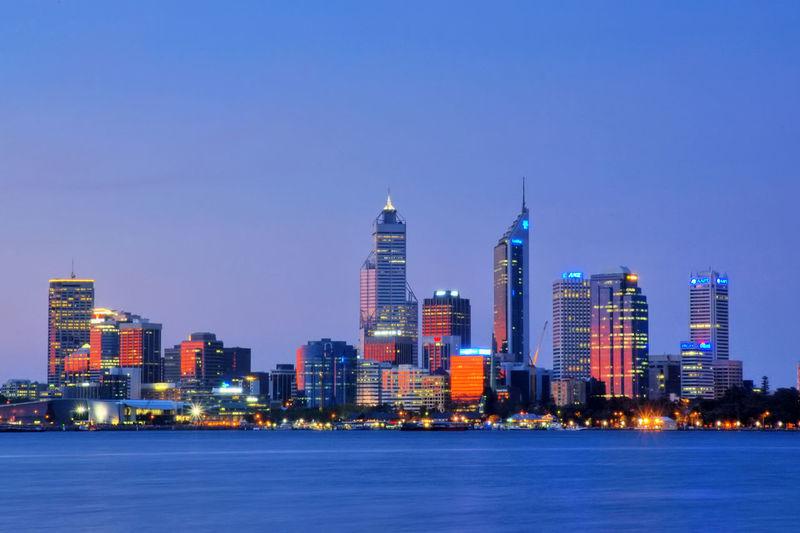 Illuminated City Against Clear Sky At Dusk