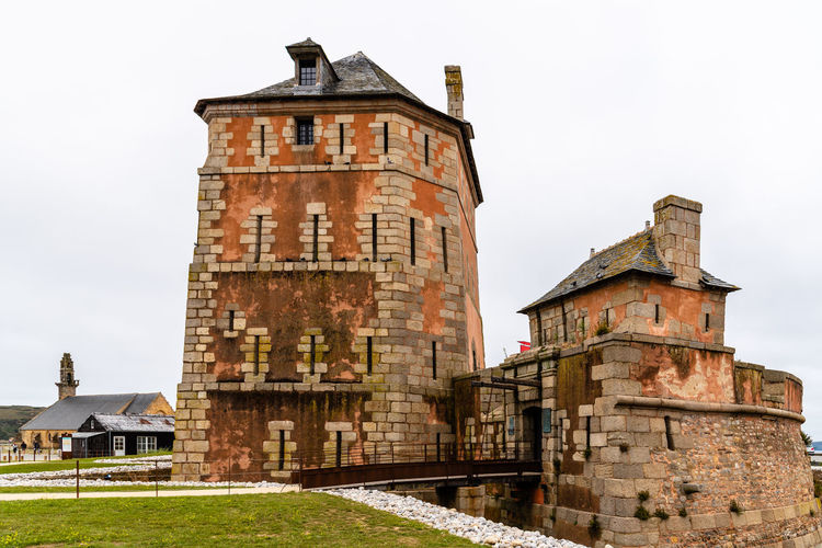 The Vauban Tower on the harbour of Camaret-sur-Mer, Finistere, Brittany Sky Nature Day Architecture Built Structure Outdoors Town Camaret-sur-Mer Brittany Crozon Harbour Building Exterior Building History The Past Old No People Clear Sky Wall Castle Vauban Fort Vauban Tower Defense Defensive Fortress Unesco UNESCO World Heritage Site Finistere
