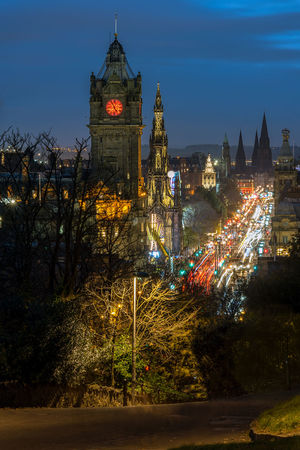 Night time view along Princes Street, Edinburgh with the Balmoral Hotels Clock tower and Scot monument taken from up Calton Hill. Blue Hour Calton Hill Edinburgh Light Trails Princes Street The Balmoral Architecture Building Exterior Built Structure City Scape Clock Face Clock Tower Clock Towers Illuminated Night No People Outdoors Sky Travel Destinations Tree