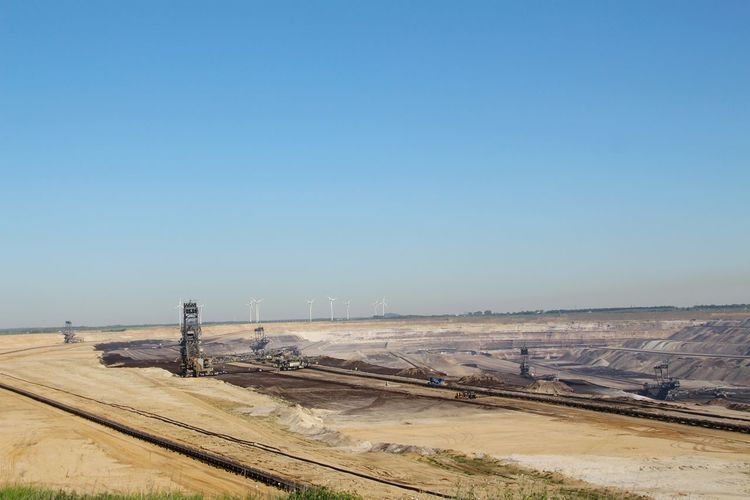 Tagebau in Nordrhein Westfalen Carbon Kohle Tagebau Outdoor Photography Indusrty EyeEm Selects Water Clear Sky Sea Beach Industry Sand Blue Sand Dune