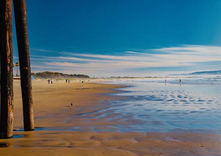 Water Sky Land Beach Sea Scenics - Nature Beauty In Nature Tranquil Scene Nature Tranquility Sand Cloud - Sky Day Incidental People Outdoors Idyllic Non-urban Scene Blue Wooden Post