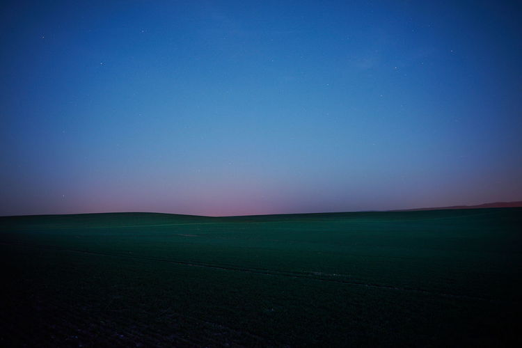 Beauty In Nature Blue Clear Sky Copy Space Dusk Environment Field Horizon Horizon Over Land Idyllic Land Landscape Nature Night No People Rural Scene Scenics - Nature Sky Tranquil Scene Tranquility