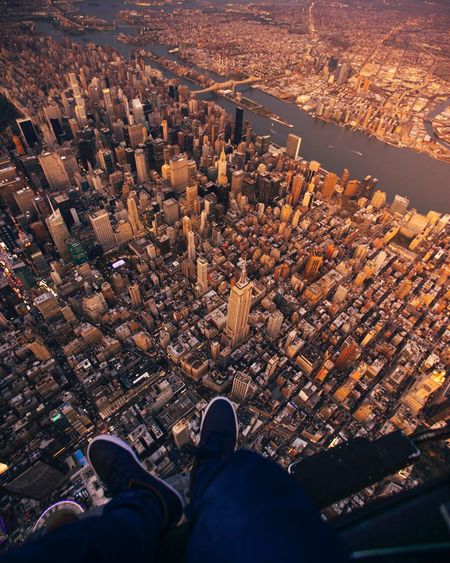 Flying high in NYC USA New York NYC High Angle View Low Section Cityscape Human Body Part Real People Standing Mobility In Mega Cities Outdoors Architecture Day One Person People
