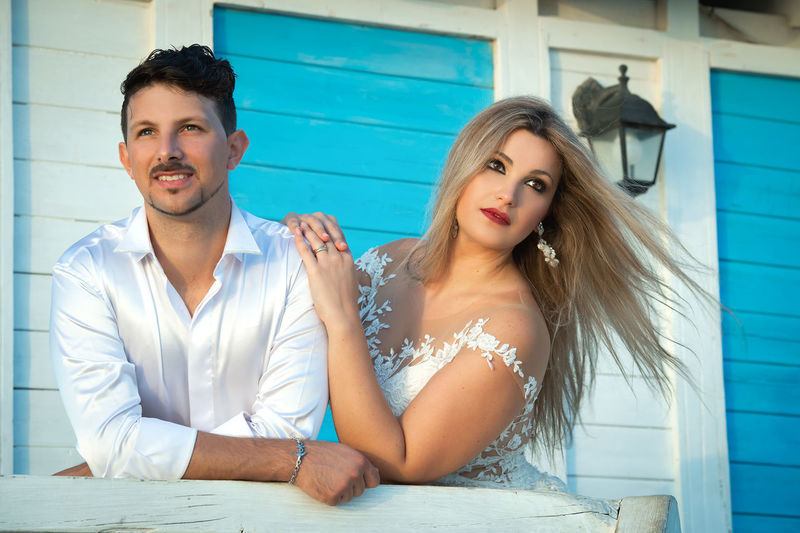 Adult Beautiful Woman Bonding Couple - Relationship Emotion Front View Hair Hairstyle Leisure Activity Lifestyles Looking At Camera Love Outdoors People Portrait Positive Emotion Real People Sitting Togetherness Two People Women Young Adult Young Men Young Women