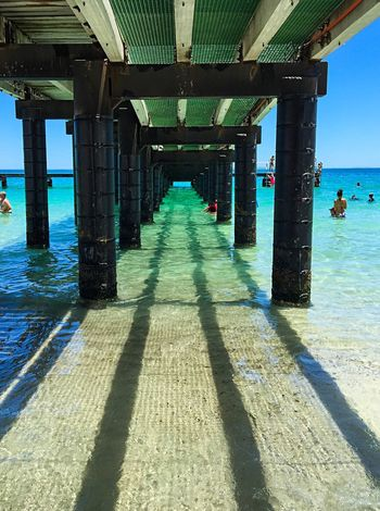 Jetty: Indian Ocean Perspective Summertime Coogee Beach Ocean Blue Blue Clear Ocean Sand Jetty Area Turquoise Water Sea Ocean Indian Ocean Shadows Jetty Shadows Under Jetty Jetty Western Australia Beach Beach Photography Australia Summer Perspective Diminishing Perspective Jetty Perspective Jetty Structure Jetty Legs