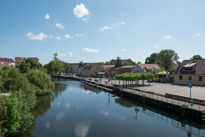 Blick auf den Stadtkanal im Alten Hafen in Rathenow Alter Hafen Havel River Havelland Germany Rathenow Stadtkanal Tourist Attraction  Architecture Bridge Building Building Exterior Built Structure Connection Day Havelland Nature No People Plant Reflection River Sky Spingtime Tree Water Waterfront Westhavelland