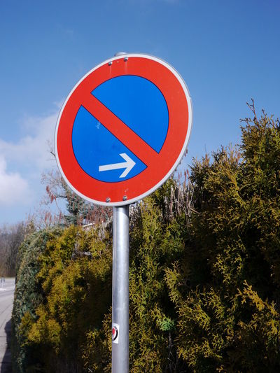 Trafficsign in south Germany Allgäu Guiding Traffic Blue Circle Communication Day Guidance Guide Low Angle View No People Outdoors Red Road Sign Sky Traffic Sign Tree