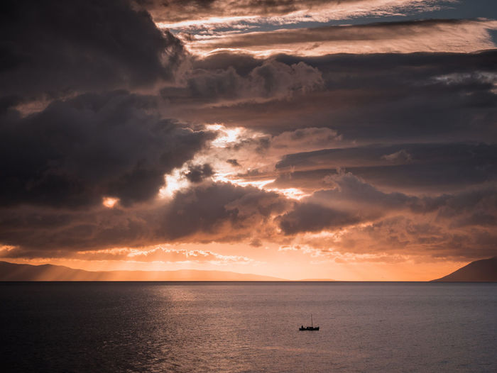 Small boat on sea and storm coming Adriatic Beauty In Nature Boat Cloud - Sky Croatia Dramatic Dramatic Sky Horizon Over Water Island Landscape Mediterranean  Nature No People Outdoors Rough Scenic Scenics Sea Sky Small Storm Cloud Sunset Vessel Water Weather