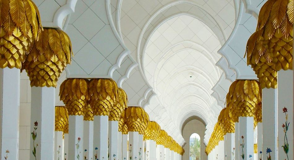 Low angle view of arches in corridor at sheikh zayed mosque