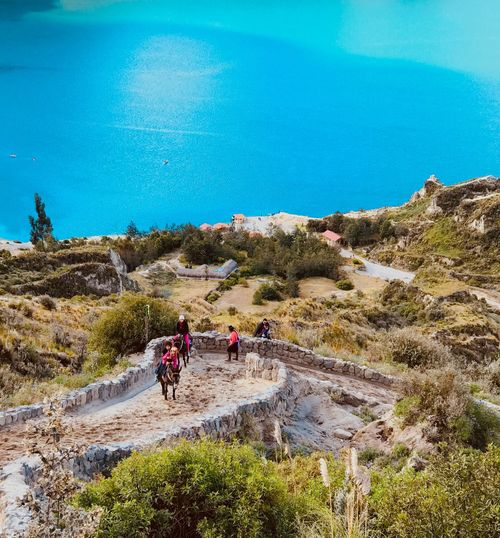 Landscape Light Blue Mule Path Trek Incidental People Lake Group Of People Real People Large Group Of People Nature Lifestyles Plant Men Crowd Leisure Activity High Angle View Women Sea Water Land Day Outdoors Beauty In Nature Beach