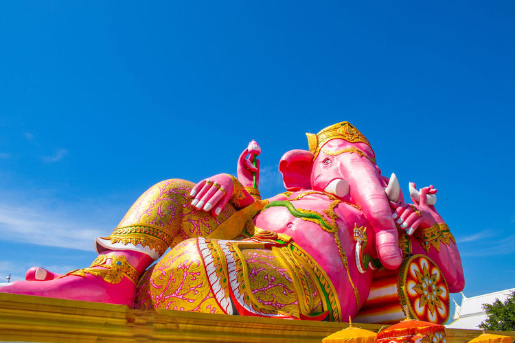 Low angle view of ganesha statue against sky