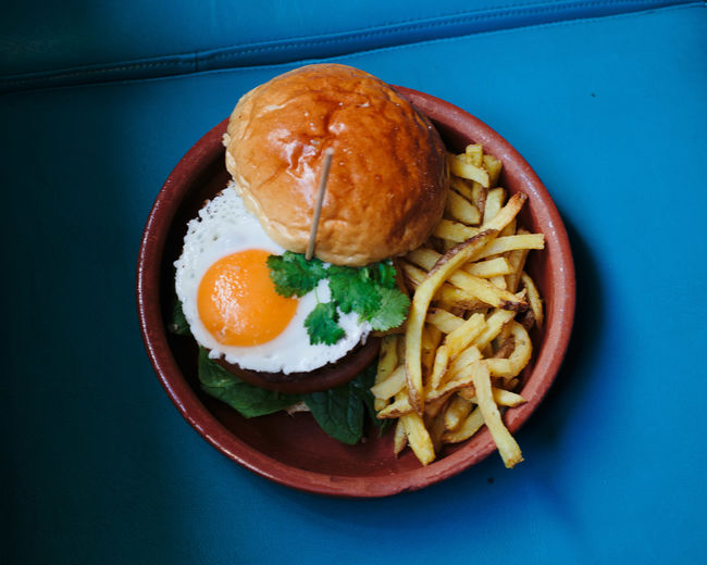not healthy eating Burger Egg Yolk Fried Egg Blue Close-up Day Egg Egg Yolk Food Food And Drink French Fries Freshness Fried Egg Hamburger Healthy Eating Indoors  Indulgence No People Plate Ready-to-eat Serving Size Table