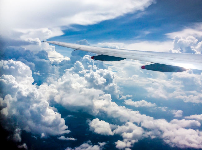 Aerial View Air Vehicle Airplane Airplane Wing Beauty In Nature Blue Cloud Cloud - Sky Clouds Clouds And Sky Day Flying Journey Low Angle View Mid-air Mode Of Transport Nature No People Outdoors Plane Spotting Plane View Plane Window Plane Wing Sky Transportation