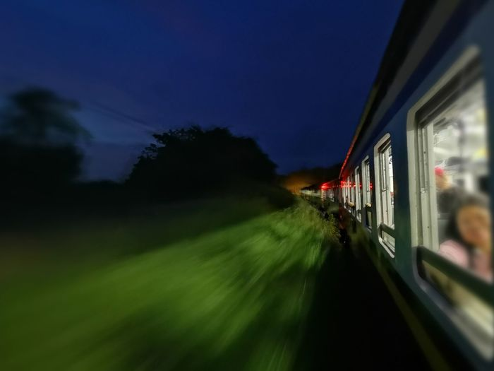 Blurred motion of train against sky at night