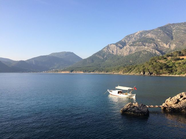 Mountain Mountain Range Beauty In Nature Scenics Nautical Vessel Nature Water Tranquil Scene Clear Sky Tranquility Transportation Day Mode Of Transport No People Outdoors Lake Waterfront Blue Sky