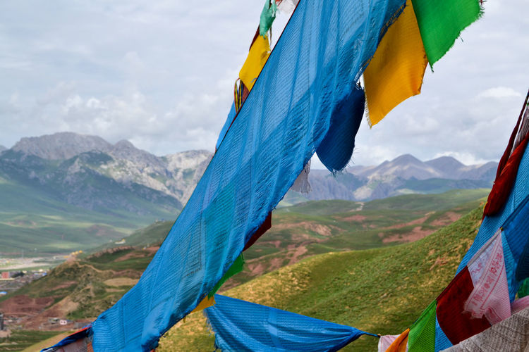 Prayer flags on mountain against sky