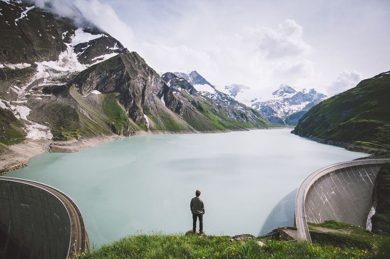 Walls to the left, walls to the right. Mountain Real People Nature Beauty In Nature One Person Scenics Water Standing Leisure Activity Casual Clothing Tranquil Scene Lifestyles Day Rear View Tranquility Lake Outdoors Non-urban Scene Mountain Range Full Length Austria