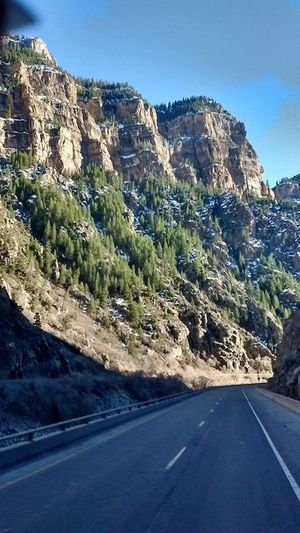 Mountain range Beauty In Nature Blue Clear Sky Curve Day Landscape Mountain Mountain Range Mountain Road Nature No People Non-urban Scene Outdoors Physical Geography Road Rock - Object Scenics Sky Sunlight The Way Forward Tranquil Scene Tranquility Transportation Tree Winding Road