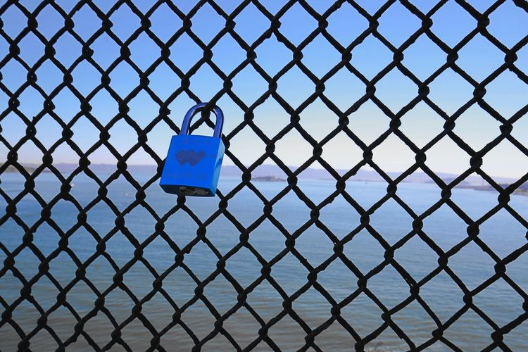 Alcatraz In Sight Blue Chainlink Fence Close-up Fence Golden Gate Bridge Hearts Lock Lock Of Love Locked No People Protection San Francisco Bay