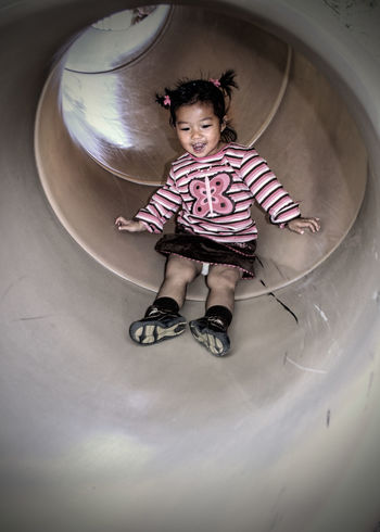 Playtime at the Park Child Childhood Childhood Playtime Fast Leisure Activity One Girl Only One Person Playground Playground Equipment Playground Slide Slide - Play Equipment Tunnel Slide Tunnel View Live For The Story
