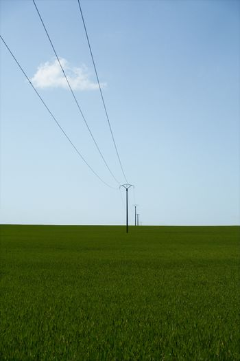 Score Cable Field Connection Electricity  Power Supply Power Line  Technology No People Day Landscape Nature Electricity Pylon Rural Scene Tranquil Scene Tranquility Grass Sky Outdoors Agriculture