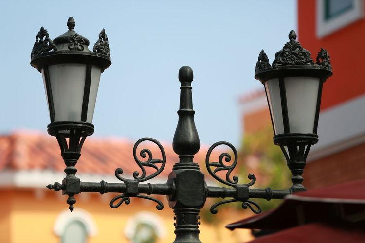 Close-up of street light against sky