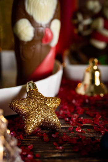Celebration Decoration Red No People Indoors  Christmas Gold Colored Close-up Figurine  Representation Food And Drink Selective Focus Holiday Focus On Foreground Human Representation Still Life Spice Christmas Decoration Christmas Ornament Luxury