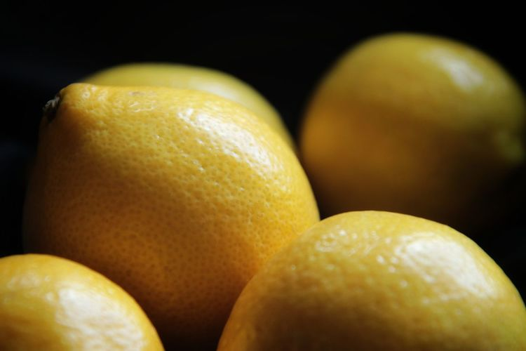 Close-up of oranges against black background