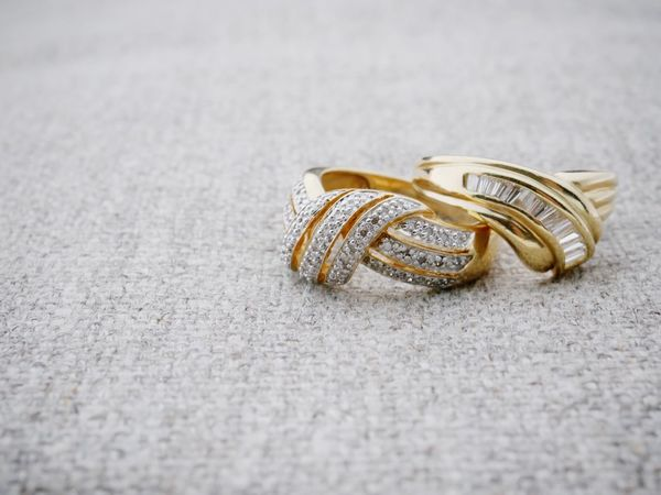 Gold rings with diamonds Jewellery Backgrounds Nobody Wedding Engagement Ring Schmuck Fabric Copy Space Jewelry Ring Wedding Event Celebration Wedding Ring Gold Colored Love No People Selective Focus Still Life Close-up Gold Wealth Two Objects Diamond - Gemstone