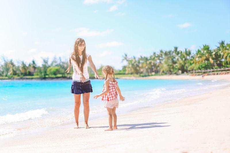 Woman standing on beach