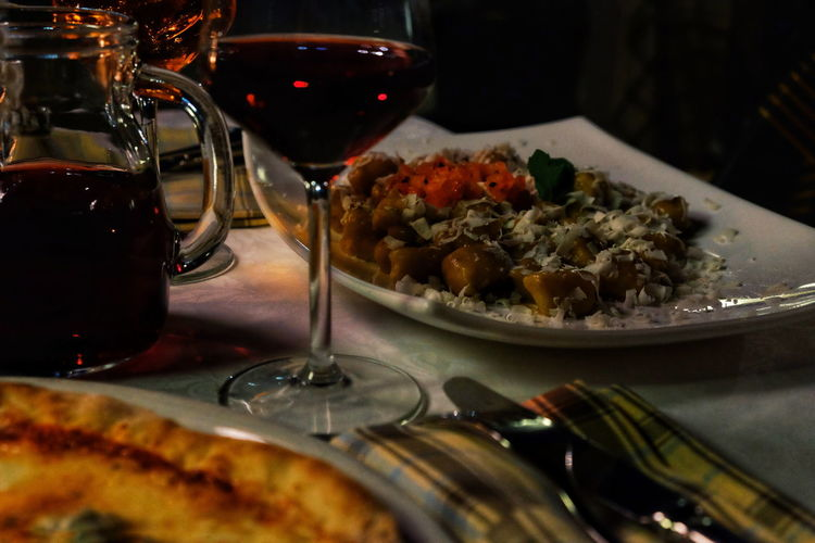 Our last dinner in Sirmione Pizza Meat Wine Pasta // Food And Drink Food Wineglass Indoors  Plate Serving Size Table Ready-to-eat No People Freshness Close-up Red Wine Refreshment Alcohol Drinking Glass Drink Healthy Eating Night FUJIFILM X-T10 XF18-55mmF2.8-4 R LM OIS F/4.9 ISO 5000 via Fotofall