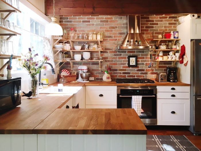 Interior Style Kitchen IKEA Brick Wall White Cabinet Wood Floors Clean Lines Modern Sunny Morning Home Remodel
