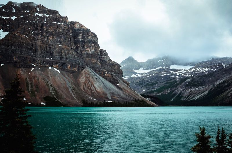 bow lake in the early summer. Water Mountain Beauty In Nature Scenics - Nature Sky Nature Tranquil Scene Lake Outdoors Mountain Range Cloud - Sky No People Cold Temperature