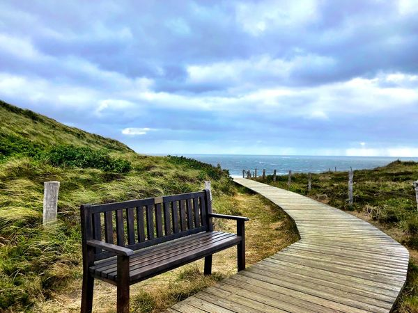 First Eyeem Photo EyeEm Best Shots - Nature EyeEm Selects Northsea Sylt Ocean Sky Cloud - Sky Sea Water Seat Tranquility Scenics - Nature Nature Beauty In Nature Tranquil Scene No People Plant Day Land Bench Beach Empty Chair Railing Horizon Over Water