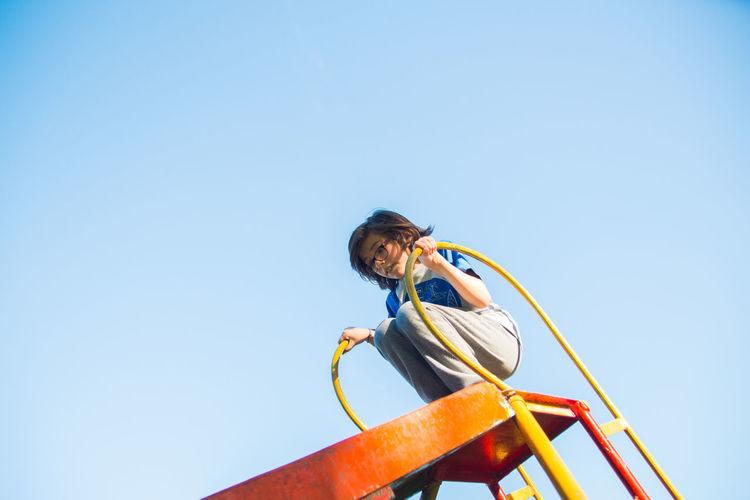 Children about to slide in playground